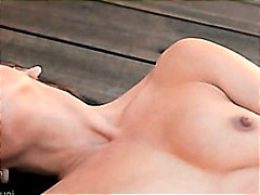 Model rubbing the clit behind the house