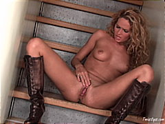 Horny babe in leather boots masturbates