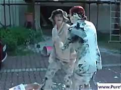 Outdoors wam scene with two messy women
