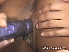 Black lesbians playing with a dildo as one girl gets her pussy re