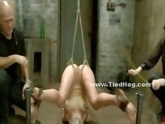 Gagged blonde has her breasts bound in rope while also being forced to cum