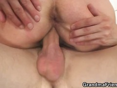 Granny is spit roasted by young cock