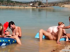 Daring hotties at the beach sharing one cock
