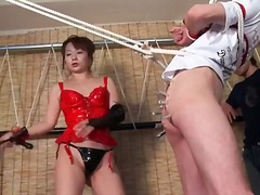 Seductive asian mistress ties up her toy boy and teases him
