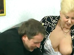 Blonde housewife sucks big cock with her
