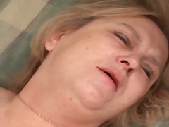 Mature in black stockings laid in her vagina