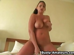 Leslie playing her huge tits while masturbating her pussy