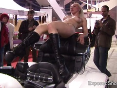 Astonishing big-titted honey teasing onto a bike