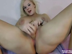 Sexy busty blonde eveline fucks her sweet pussy