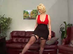 Siri is s curvy blond-haired domina
