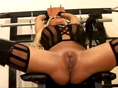 Blond-haired slave milf with legs apart