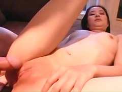 Shaved cunt of young asian sits on dick