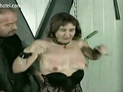 Mature slave gets hits on her pussy and pulled on her nipple