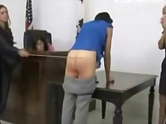 Tall girl getting her ass spanked red with stick by the woman judge on the desk to avoid jail