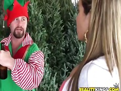 Christmas eld guy trying to seduce a young beautiful lady.