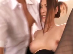 This sexual milf from japan yuna shiina looks really breathtaking. she stays in stockings and high heels before getting her breasts and hairy pussy caressed by two dudes.