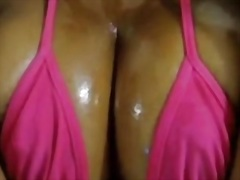 Oiled up dark boobs are outstanding