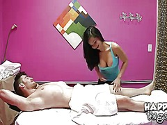 Adorable asian masseuse kimmy lee surprises a horny bloke gavin kane with tugging on his hard dick